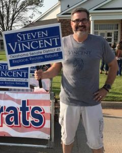 Man holds Steve Vincent sign